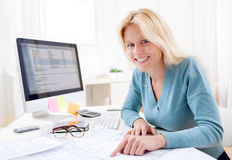 Blonde architect watching blueprint at the office Stock Photos