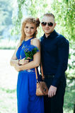 Blonde attractive couple standing against natural Royalty Free Stock Image