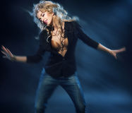 Blonde attractive woman on the dance floor Stock Photos