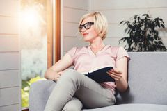 Blonde Attractive Woman Reading Book stock image