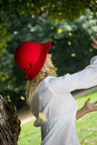 Blonde autumn girl with red hat Stock Images