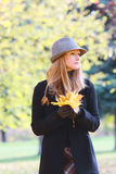 Blonde with autumn leaves Stock Photos