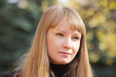 Blonde in autumn sunlight Stock Photography