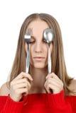 Blonde avec la fourchette et la cuillère Photos stock