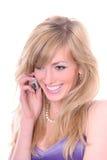 Blonde avec le mobile Image libre de droits