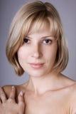 Blonde avec les yeux bruns Photos stock