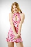 Blonde avergonzado en rosa Fotos de archivo