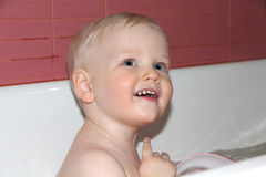Blonde baby boy in bathroom Royalty Free Stock Photography