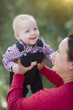 Blonde Baby Boy Playing With His Mommy Outdoors Stock Photography