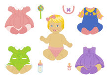 Blonde baby-girl. A blonde baby-girl with a set of clothes Stock Photo