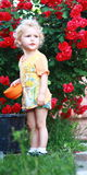 Blonde baby girl gardener Stock Photo