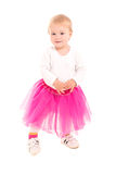 Blonde baby girl in pink tutu and sneakers Royalty Free Stock Image