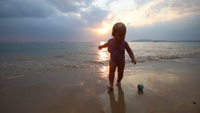Child Play on the Beach at Sunset stock footage