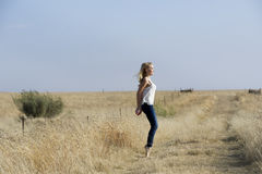 Blonde ballerina dancing in field stock photos