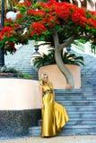Blonde on ballustrade Stock Images