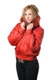 Blonde bastante joven en chaqueta roja Imagenes de archivo