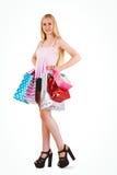 Blonde bastante joven que sostiene los panieres Imagen de archivo libre de regalías
