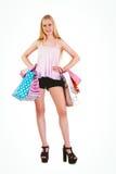 Blonde bastante joven que sostiene los panieres Imágenes de archivo libres de regalías