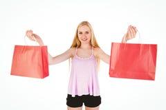 Blonde bastante joven que sostiene los panieres Fotos de archivo libres de regalías