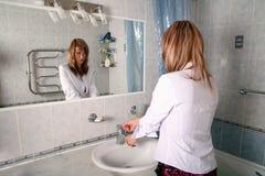 Blonde in bathroom Stock Image