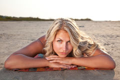 Blonde on beach towel Stock Photos