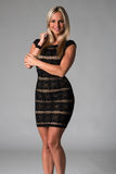Blonde. Beautiful Czech blonde in a sleeveless lace dress Royalty Free Stock Photography