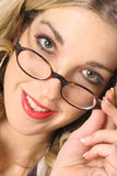 Blonde with beautiful eyes in glasses. Shot of a blonde with beautiful eyes in glasses Stock Photos