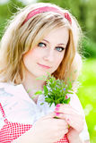 Blonde beautiful girl portrait with flowers. Blonde beautiful girl portrait with small flowers Royalty Free Stock Photography