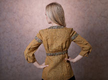Blonde beautiful girl posing from behind royalty free stock photography