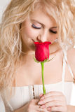 Blonde with beautiful red rose. Blonde girl with beautiful red rose stock photo