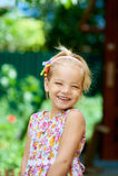 Blonde beautiful smiling little Stock Image