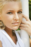 Blonde  beautiful woman in a park Royalty Free Stock Images