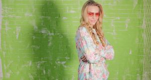 Blonde beautiful woman in sunglasses posing. stock video footage