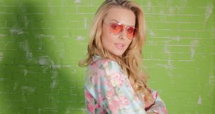 Blonde beautiful woman in sunglasses posing. stock video