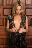 Blonde. Beautiful young blonde woman in a brown paisley dress Royalty Free Stock Images