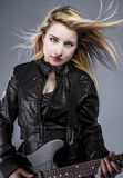 Blonde, Beautiful young woman dressed in black rock with electri Stock Image