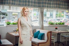 Blonde beautifull businesswoman posing in a restaurant. The owner of the restaurant Stock Photo