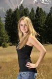 Blonde beauty. Teen blonde girl n meadow Royalty Free Stock Image