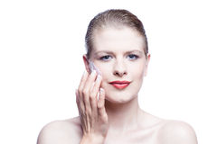 Blonde beauty applying face cream Stock Images