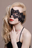 Blonde beauty girl with mask Stock Image
