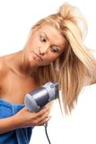 Blonde beauty with hair drier Stock Photos