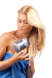 Blonde beauty with hair drier Royalty Free Stock Photography