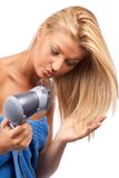 Blonde beauty with hair drier Royalty Free Stock Images
