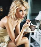 Blonde beauty on a lunch break Royalty Free Stock Image