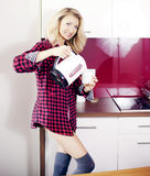 Blonde beauty at morning in kitchen. Royalty Free Stock Photo