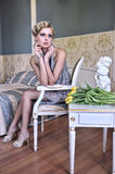Blonde beauty in a old room with tulips Royalty Free Stock Photo
