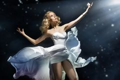 Blonde beauty posing. Over starry background Stock Photography