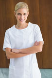 Blonde beauty therapist smiling at camera Royalty Free Stock Photos