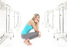 Blonde beauty in a wardrobe Royalty Free Stock Photography