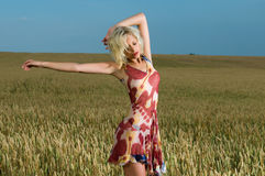 Blonde beauty in wheat field Stock Photo